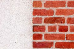 Haft Brick Wall with Concrete Wall Background. Close up Haft Brick Wall with Concrete Wall Background stock photo