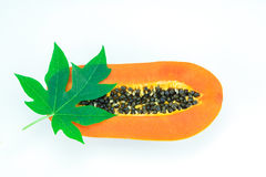 Haft cut papaya fruit and papaya leaf. Isolated over white background Royalty Free Stock Images