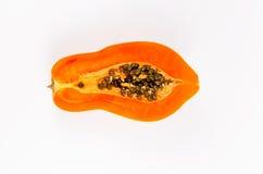 Haft of fresh papaya. Isolated on white background Royalty Free Stock Photos
