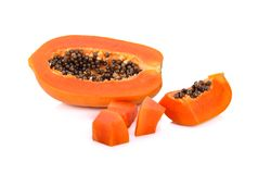 Haft and portion cut ripe papaya with seeds on white background. Haft and portion cut ripe papaya with seeds on a white background stock photos