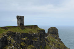 Hag`s Head Tower in Ireland. Tower on the cliffs at Hag`s Head in Ireland Royalty Free Stock Photo