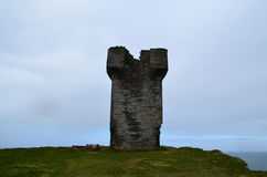 Hag`s Head Tower in Ireland. Tower on the cliffs at Hag`s Head in Ireland Royalty Free Stock Image
