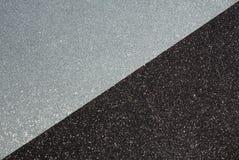 Haga el papel del brillo a mano en los colores del negro y de la plata, fotografía de archivo libre de regalías