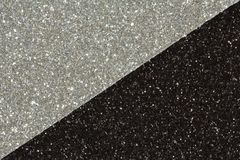 Haga el papel del brillo a mano en los colores del negro y de la plata, imagen de archivo libre de regalías