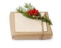 Haga las cajas de regalo a mano con la tarjeta de felicitación para el texto La Navidad, fondo del día de fiesta del Año Nuevo ai Fotografía de archivo