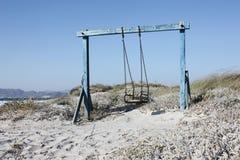 Haga pivotar en la playa con la arena Fotografía de archivo