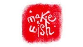 Haga un deseo que pone letras dentro de un marco congelado con nieve en Chromakey rojo stock de ilustración