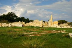 Hagar Qim - megalithic temple complex in Island of Malta. Hagar Qim - megalithic temple complex found on the Mediterranean Island of Malta, dating from 3600-3200 Royalty Free Stock Photo