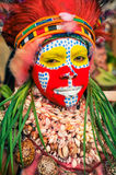 Hagen show in Papua New Guinea. Hagen show, Papua New Guinea - circa August 2015: Native woman has colours on her face during preparation for Hagen show, Papua Stock Image