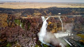 Hagerman Valley hatchery water collection plant near a waterfall. Thousand springs hatchery water collection plant with waterfall Royalty Free Stock Image