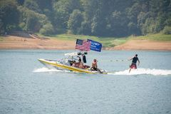 Motor boat with american and pro-trump flags on the lake stock photography