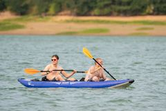 Two friends on the lake royalty free stock photography