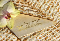 Haggadah of Passover. Spring holiday of Passover and its attributes, with matzo and Haggadah in hebrew and english - Happy Passover Stock Image