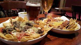 Haggis Nachos in a Scottish Bar with Beers Stock Images