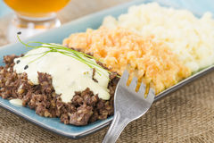Haggis, Neeps & Tatties. Haggis, Neeps & Tatties - Traditional Scottish meal commonly served at Burns' Night. Served with a dram Stock Image
