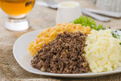 Haggis, Neeps & Tatties. Haggis, Neeps & Tatties - Traditional Scottish meal commonly served at Burns' Night. Served with a dram Stock Photo