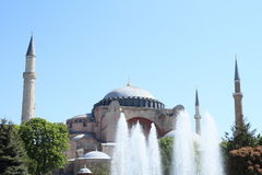 Hagia Sofia in Istanbul. Former church and mosque and current museum Hagia Sofia with minarets behind spouting fountain in Sultanahmed Arkeolojik Park in Stock Photos