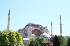 Hagia Sofia in Istanbul. Former church and mosque and current museum Hagia Sofia with minarets behind trees in Istanbul, Turkey Royalty Free Stock Photo