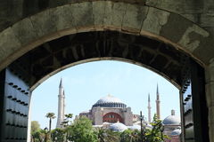 Hagia Sofia in Istanbul. Former church and mosque and current museum Hagia Sofia with minarets viewed from opened entrance gate of Sultan Ahmed Mosque or Blue Stock Photography