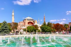 Hagia Sophia Ayasofya museum with fountain in the Sultan Ahmet Park in Istanbul, Turkey during sunny summer day. stock photos