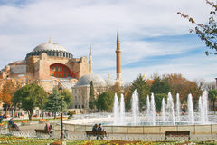 Hagia Sophia byzantine church in Istanbul and fountain in a park. View of the byzantine church of Hagia Sophia in Istanbul, the ancient Constantinople and of the royalty free stock photos