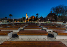 Hagia Sophia at dusk with wooden bench in foreground Stock Photos