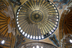 Hagia Sophia interior. Interior dome of Hagia Sophia (Aya Sofia) church in Istanbul, Turkey, with islamic and orthodox symbols Stock Images
