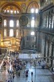 Hagia Sophia interior at Istanbul Turkey. ISTANBUL, TURKEY - MAY 20, 2016 - Tourists in interior of Hagia Sophia (Hagia Sofia, Ayasofya) in Istanbul, Turkey Stock Images