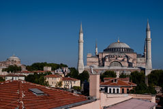 Hagia Sophia, Istanbul. Showing dome and minarets against a blue sky with moon rising Royalty Free Stock Image