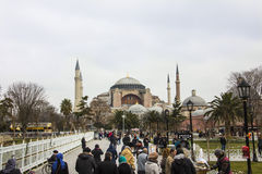 Hagia Sophia, Istanbul. The Hagia Sophia of Istanbul. In front are tourists and street sellers Royalty Free Stock Image