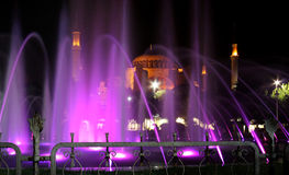 Hagia Sophia, Istanbul, Turkey. A night scene of the Hagia Sophia in Istanbul behind a purple water fountain royalty free stock photography