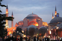 Hagia Sophia Mosque. The Hagia Sophia Mosque in Istanbul and the people walking in park Sultanahmet at the evening Royalty Free Stock Image