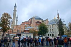 The Hagia Sophia museum. ISTANBUL - TURKEY - OCT 28: Hundreds unidentified tourists visiting every day, defying weather, the Hagia Sophia museum. Hagia Sophia is stock photography