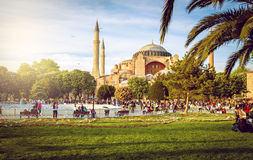 Hagia Sophia and people around. View of Hagia Sophia entrance with people relaxing around Stock Photos