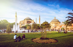 Hagia Sophia and people around. View of Hagia Sophia entrance with people relaxing around Royalty Free Stock Photography