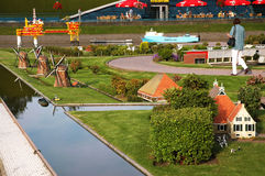 THE HAGUE, HOLLAND, SEPTEMBER 2005 � an unidentified woman in miniature city Madurodam Royalty Free Stock Photo