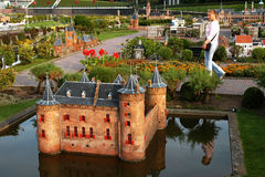 THE HAGUE, HOLLAND, SEPTEMBER 2005 � an unidentified woman in miniature city Madurodam Royalty Free Stock Images