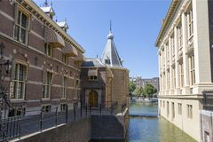 Fragment of buildings Binnenhof with part of the palace pond stock images