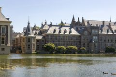 View of the Binnenhof from the palace pond. stock photo