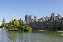 View of the Binnenhof from the palace pond. stock image