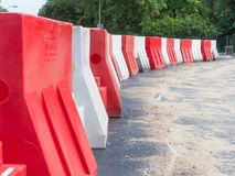Plastic barriers on newly constructed road. The Hague, the Netherlands - 16 June 2018: plastic barriers on newly constructed road royalty free stock image