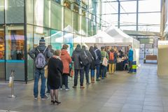 Voters lining up to vote in train station polling booth. The Hague, the Netherlands - March 21, 2018: voters lining up to vote in train station polling booth Stock Photo