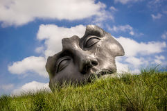 HAGUE, NETHERLANDS - MAY 19, 2014: Famous abstract sculptures. Famous abstract sculptures of a mens face Stock Image