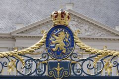 The Hague, The Netherlands - May 15 2020. A view of a coat of arms with a crown, on the fence in front of Noordeinde Palace, royal