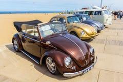 Classic beetle vehicles at the beach. The Hague, the Netherlands - 21 May, 2017: VW classic beetle vehicles at Scheveningen beach car show Stock Photos