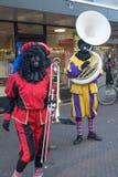 Black piet/zwarte piet celebrating Sinterklaas stock images