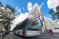 The Hague public transportation. Fast speed transportation concept of Dutch bus running at the center of The Hague through the modern buildings, Netherlands Stock Photo