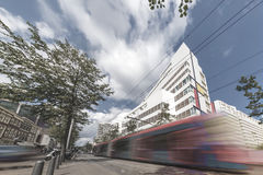 The Hague public transportation. Fast speed transportation concept of Dutch tram running at the center of The Hague through the modern buildings, Netherlands Royalty Free Stock Image