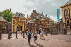 Gateway in the Binnenhof Gothic public buildings inner courtyard at The Hague. stock photos