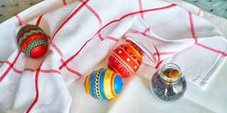 Hahd made souvenir Easter eggs from papier-mache on kitchen table Royalty Free Stock Photos